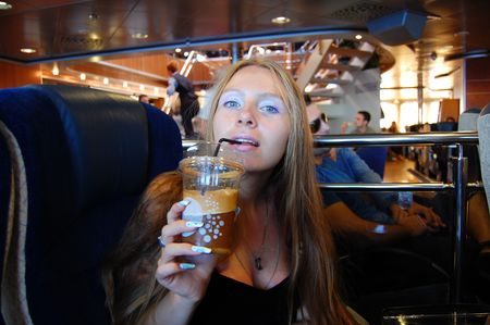 Young girl drinking Greek frappe in a ferry cafe Stock Photo - 3698188