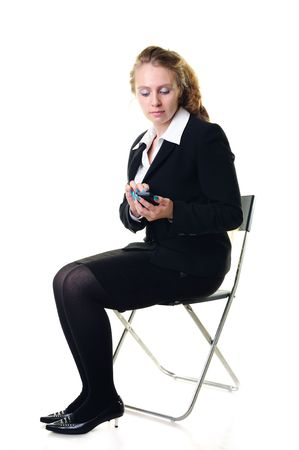Young businesswoman operating a smartphone Stock Photo - 8293196