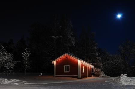 Turku, Finland - January 02, 2010: Beautiful Christmas house in moonlight