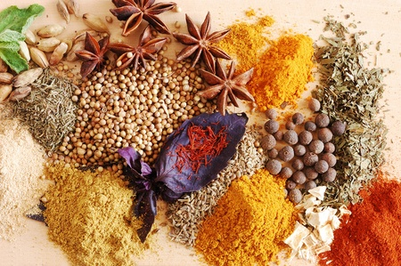 Various kinds of spices on wooden surface photo