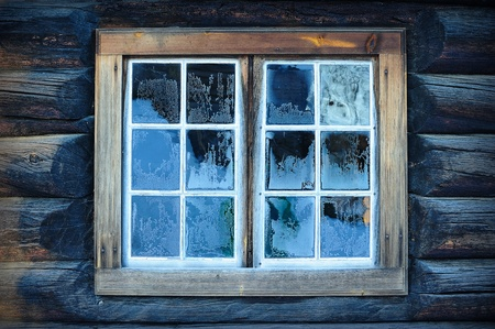 Window of a traditional Norwegian hut with frost patterns