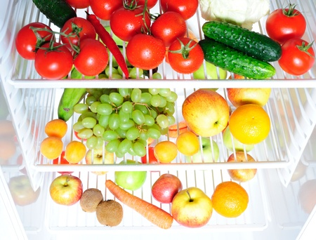 Refrigerator full of fruit and vegetables photo