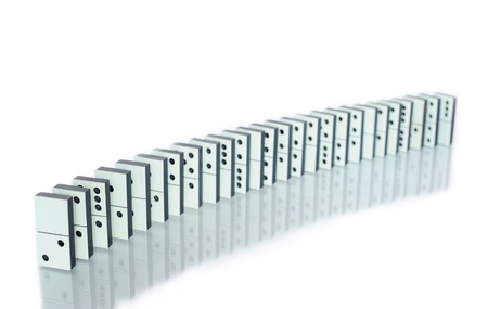 Row of dominoes with reflection on white Stock Photo - 8863424