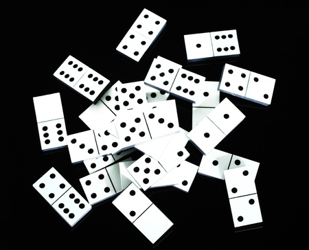 Dominoes scattered on black background Stock Photo - 8863429
