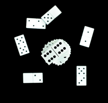 Dominoes scattered on black background Stock Photo - 8863421