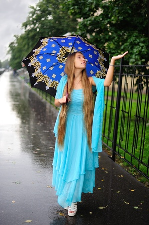 Girl touching the rain Stock Photo - 10498005