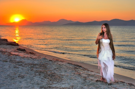 attitude girls: Beautiful lonely girl on the seashore Stock Photo