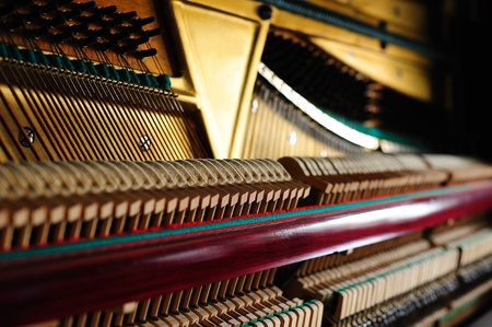 Strings and hammers inside of the old piano Stock Photo