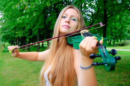 Girl playing the green violin Stock Photo - 10522265
