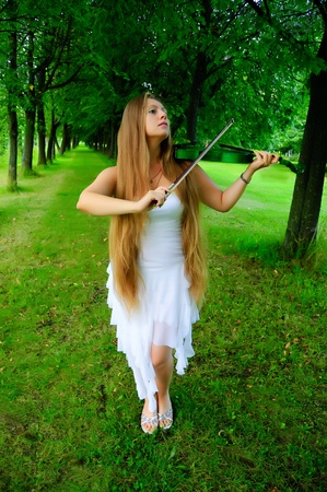 Young girl playing the green violin  photo