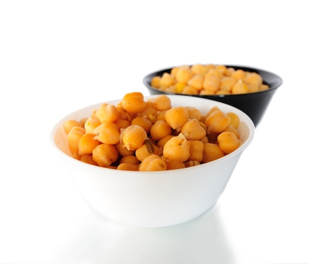 garbanzo bean: White and black bowls of cooked chick peas
