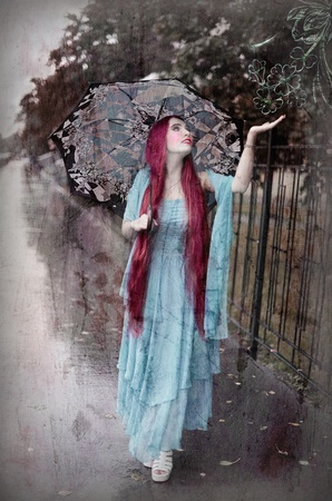 Smiling girl with umbrella under the rain, retro styled photo photo