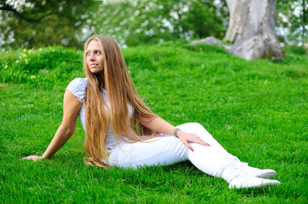 Girl sitting on green grass Stock Photo - 10814869