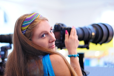 Young girl with a camera photo
