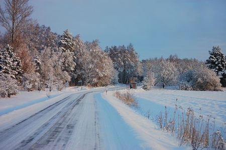 Winter road covered with snow photo