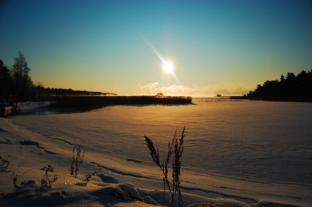 Frozen lake on a sunny winter day photo