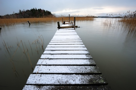 Landscape with pier in winter