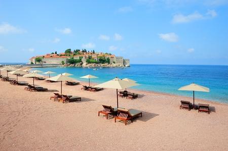 sveti: Beautiful beach with sunshades near Sveti Stefan island in Montenegro Stock Photo