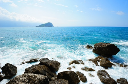 budva: Foamy Adriatic sea landscape with the island of Sveti Nikola in the distance