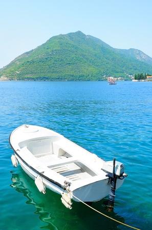 White sailboat at blue sea  photo