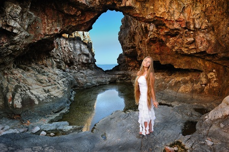 Girl in the cave on the island of Locrum near Dubrovnik, Croatia Stock Photo