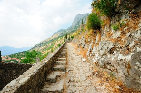 Stairs of the old fortress in Montenegrin town Kotor photo