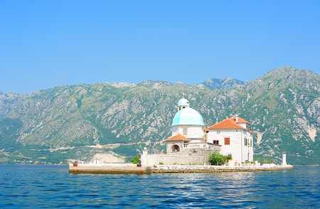 Gospa od Skrpela - Church of Our Lady on the Rocks on the artificially built island in Perast, Montenegro Stock Photo