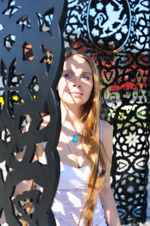 inscrutable: Portrait of a pretty girl with intricate shadows