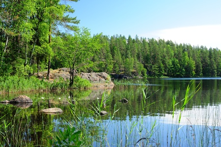 One of the wonderful lakes in Finland hidden in the forest  Stock Photo