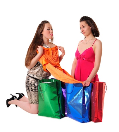 boasting: Girls shopping - one girl boasting before another of her newly bought fashionable dress