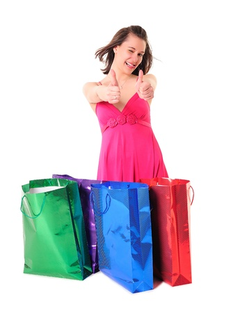 Cute funny shopaholic girl showing OK sign and putting her tongue out  Stock Photo - 13219335
