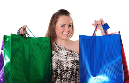 Portrait of a beautiful girl holding large colorful shopping bags with purchases photo