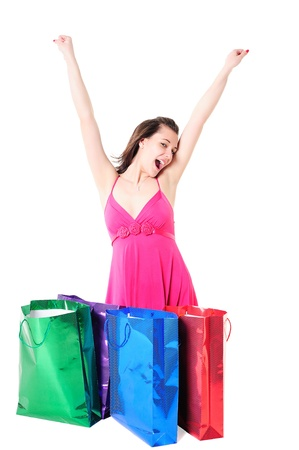 Happy shopaholic girl with shopping bags holding her arms up Stock Photo - 13330011