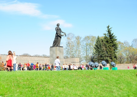 SAINT-PETERSBURG, RUSSIA - MAY 9: On Victory day people came to honor the memory of the buried soldiers on Piskaryovskoye Memorial Cemetery on May 9, 2011 in Saint-Petersburg, Russia