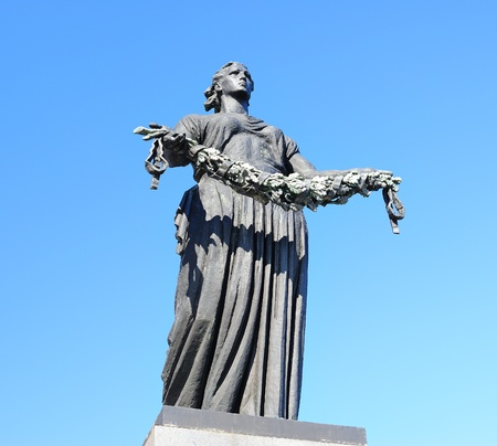 SAINT-PETERSBURG, RUSSIA - MAY 9: Statue of Mother Homeland on Piskaryovskoye Memorial Cemetery on May 9, 2011 in Saint-Petersburg, Russia