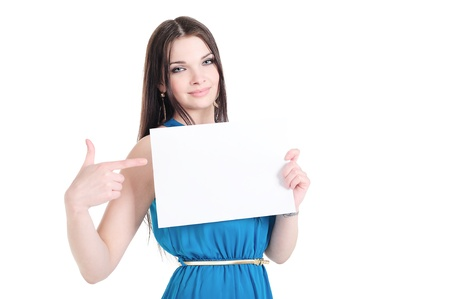 Beautiful young smiling girl holding a sheet of paper with copyspace for text photo