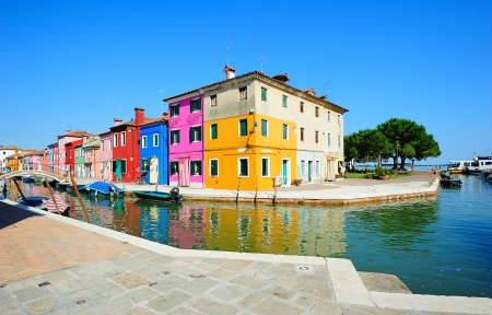 Burano island colorful scenery with toylike houses along the canal embankment (Venice, Italy) Stock Photo