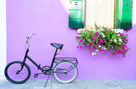 Lanscape with an old bike at a lavender house (Burano island, Venice) photo