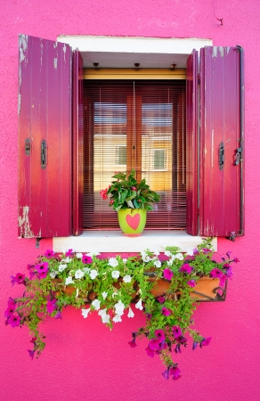 Window of a crimson house (Burano island, Venice) Stock Photo