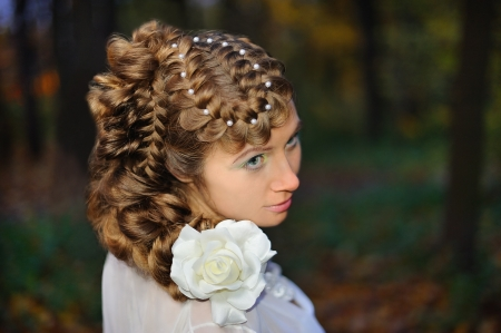 Portrait of a bride with a stylish hairdo photo