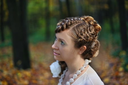Half-face portrait of a bride with a stylish hairdo photo