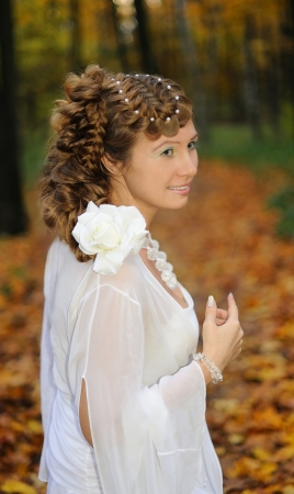 Portrait of a bride with long hair braided in plaits photo