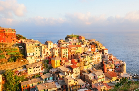 Picturesque sunset in colorful Manarola village (Cinque Terre, Italy)
