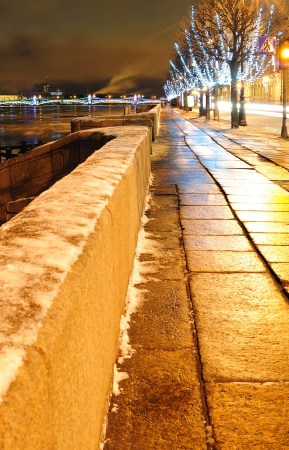 Christmas street in St. Petersburg with view to the Neva river  photo