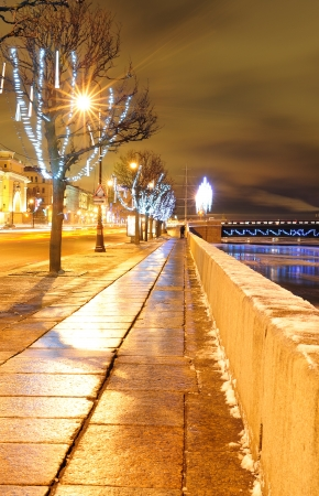 Christmas Neva embankment in St. Petersburg decorated with fairy lights photo