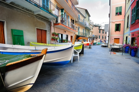 Street with fishing boats in an Italian village Manarola (Cinque Terre, Italy) photo