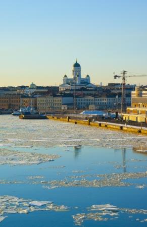Helsinki spring landscape with Tuomiokirkko in ice drift time photo