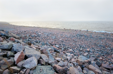 baltic sea: Rocky Baltic sea shoreline in the cold mist