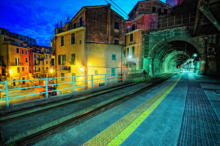 train: Train platform and a tunnel in Vernazza village, Italy Stock Photo