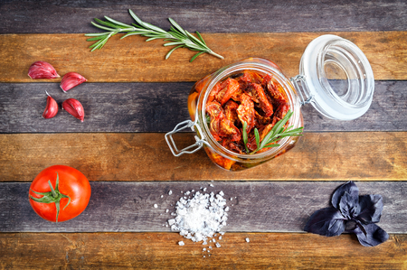 sundried: Sun-dried tomatoes with rosemary and garlic in a glass jar